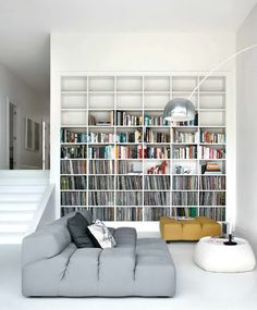 i love the idea with the records and the books.. Shelvings are great though i would have a less squared off appearance