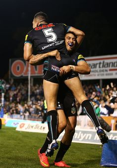 Dean Whare and Dallin Watene-Zelezniak Photos - Dean Whare and Dallin Watene-Zelezniak of the Panthers celebrate a try by Dallin during the round 26 NRL match between the Penrith Panthers and the New Zealand Warriors at Sportingbet Stadium on September 7, 2014 in Sydney, Australia. - NRL Rd 26 - Panthers v Warriors