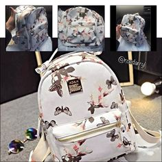 "Floral Butterfly Carryall Backpack Super Pretty and roomy backpack.  Fit for carrying tablet, phone.  With lots of zippers that work well.  Made of Leather measures: 8""x4""x10"" Boutique Bags Backpacks"