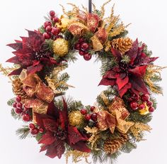 Decorated with a variety of holiday floral including pine, hydrangea, mums and berries. Great for the front door or over a mantel. Features - 24 inch - Made-to-Order In Powell Ohio - Designer Quality
