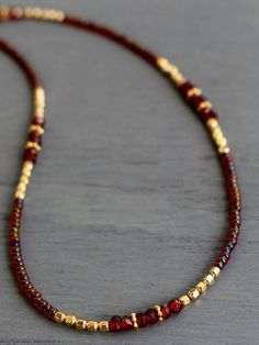Garnet necklace, January birthstone necklace, garnet and gold beaded necklace, delicate gemstone necklace, layering necklace, gifts for her With its sophisticated, regal presence and ultra-elegant color combination this Tam Davis garnet necklace is a standout on its own or layered #jewelrygram #instajewelry #gemstone #cbloggers #lbloggers