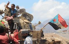 "Supporters of Yemen's Southern Separatist Movement stand next to a tank flying the movement's flag near the International airport in the port city of Aden, as battles against Shiite Huthi rebels continue, on May 2, 2015. UN Secretary-General Ban Ki-moon has warned that fuel shortages could bring all relief operations to a halt ""within days,"" echoing alarm from the International Red Cross and other embattled aid agencies. AFP PHOTO / SALEH AL-OBEIDI (Photo credit should read SALEH…"