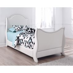 Invite contemporary design into your home with this chic upholstered sleigh bed. This bed features a soft white faux leather upholstery that complements any style in your home.