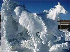 Snow Art - An amazing sculpture of horses in the snow