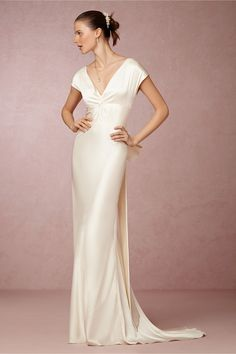 Cassandra Gown in New at BHLDN - Simple and gorgeous. Not so sure about the bow in the back though...