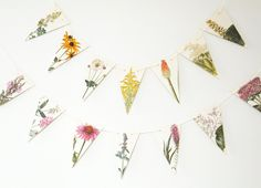 Flower Bunting, Flower Garland, Recycled Paper Garland, eco-friendly banner, dorm decor, pennants by PeonyandThistle on Etsy https://www.etsy.com/listing/242709369/flower-bunting-flower-garland-recycled