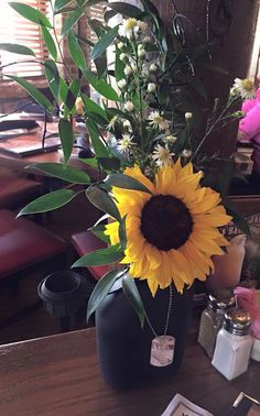 Military Floral Decor used as table decorations at a Hail & Farewell. Water canteen sprayed black with Dog Tag decor. Military Retirement Parties, Military Party, Retirement Ideas, Military Gifts, Military Ball, Military Style, Medal Display Case, Water Canteen, Farewell Gifts