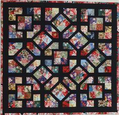 simple four patch blocks made from 3 1/2″ strips or squares, the eight diagonally set blocks are machine blanket stitchd in place!