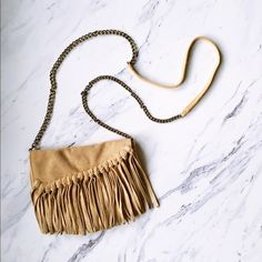 Fringe Suede Chain Crossbody Purse Super cute small fringe purse with no brand tags. Found at a small boutique. Perfect condition! Very trendy! Bags Crossbody Bags