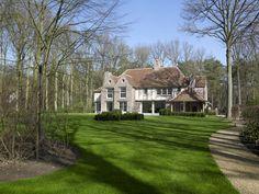 Engelse Mansion met eiken vakwerk in gevels - Villabouw Sels