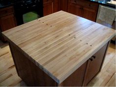 We reclaimed the lanes from an old bowling alley. A few sections found new life as the top to a large center kitchen island.