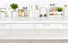 Wooden planks table over blurred image of kitchen bench interior royalty-free stock photo