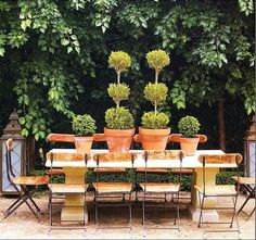 dining area, bistro chairs and topiaries