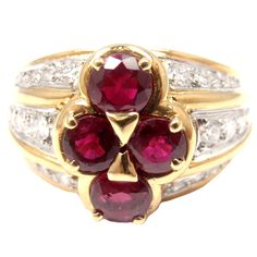 18k Yellow Gold Diamond & Ruby Ring by Van Cleef & Arpels. With 28 diamonds and a total diamond weight of: .47ct VS clarity, G color. Also with 4 total rubies with a total Ruby weight of: 1.28ct. 1970s