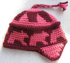 Tapestry Crocheted Hat inspired by the Inuit Toques / Pang Hats. My original bear pattern. Made of thick acrylic yarn. Size medium. Fits a 22- 22
