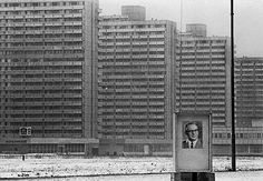 1975 - East Berlin: Oppressive Soviet apartment blocks with a poster featuring leader Erich Honeker.