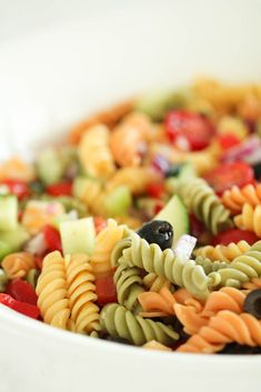 This easy pasta salad is made with rotini pasta, cucumber, tomato, olives, pepperoni, cheese, green bell pepper, red bell pepper, red onion, cheese and Italian dressing for plenty of flavor! Homemade Pasta Salad, Best Pasta Salad, Pasta Salad Recipes, Pasta Meals, Potluck Recipes, Side Dish Recipes, New Recipes, Cooking Recipes, Budget Recipes