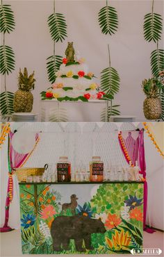 Eclectic creative touches. This couple incorporated their 'spirit animals' into their day with cute wedding toppers and a vibrant mural decorating the drinks bar. Loving the gold sprayed pineapples too Images copyright Lucabella. www.lucabella.co.uk