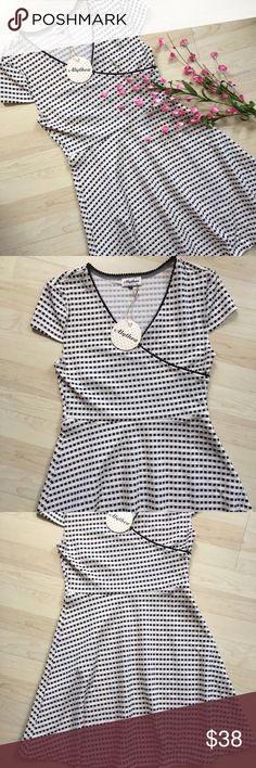 """NWT black and white wrap fit and flare dress Gorgeous wrap style fit and flare dress. ~34"""" long, 28"""" waist and 32"""" bust. Will stretch to accommodate larger measurements. 95% polyester and 5% spandex. New with tags! Alythea Dresses Midi"""