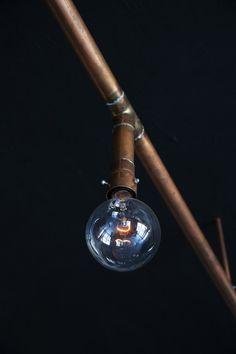 copper lighting designed by Richard Lindvall for restaurant and bar nazdrowje