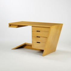 DAN JOHNSON  desk  Haden Hall USA , 1947 bleached walnut 53 w x 24 d x 31 h inches Desk features three drawers and one pull-out writing surf...