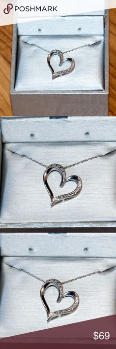 Zales New Heart Diamond Accent in Sterling Silver NEW IN THE BOX Heat Diamond Accent in Sterling Silver.  Not too big and not too showy, this glistening diamond-accented heart pendant is a meaningful gift of romantic love. Fashioned in sterling silver, this looping heart is scattered with shimmering diamond accents and finished with a polished shine. Certain to become one of her most treasured pieces, this heart suspends slightly askew along an 18.0-inch rope chain that secures with a…