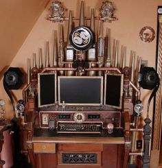 The whole setup offers 3 monitors, a printer, scanner, webcam, horn speakers, #Steampunk iPhone dock, card readers and a built-in clock. H.G. Wells and Jules Verne would love to sit there and write :)