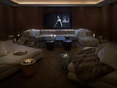"Awesome home theater meets ""swank club in a big city"" feel. Great job!"