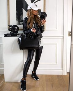 This casual outfit for the gym can also transition easily into a street style look. To get the look, pair an oversized hoodie with spanx faux leather leggings and nike air max 270 sneakers. Finish it off with a baseball cap and faux leather jacket. To see more cute gym outfits for women, fall athleisure outfits, and leather leggings outfits, visit Mia Mia Mine. #athleisure #nike #falloutfits