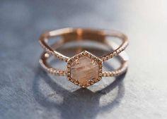 Think beyond the cushion-cut diamond- raw stone engagement ring