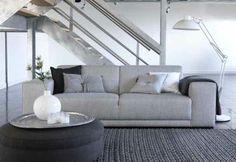 Pale grey modern sofa (Ikea Kivik is a similar shape) textured charcoal rug - Sofa BIG vanaf 899,- houseofmayflower.nl