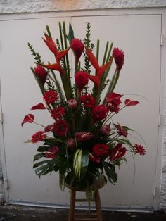 red tropical flower arrangement for wedding and events.