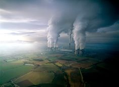Coal power plant, United Kingdom. The tall center structure is a stack from the plant, while the surrounding structures are its cooling towers.