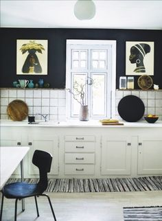 Danish old school kitchen with drawings on the wall by illustrator Aage Sikker Hansen