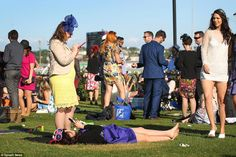 Wearing a glamorous purple dress and a fascinator, one woman was seen having a rest on the grass as the party continued around her Melbourne Cup, Stakes Day, Purple Dress, Fascinator, Barefoot, Finals, Grass, Dolores Park, Carnival