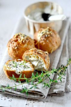 Gougères - French County Cheese Puffs With Fresh Herbs _ A Gougère, in French cuisine, is a baked savory choux pastry made of choux dough mixed with cheese. I Love Food, Good Food, Yummy Food, Yummy Yummy, Fingers Food, Cheese Puffs, Cheese Pastry, Fresh Herbs, Fresh Thyme