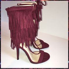 Burgundy Fringe Heels Size 8.5 New pair of burgundy fringe heels. Ties up around the ankle/zips up the back.  Size 8.5.  Approx 4 1/2 in. heel.  Please comment if you have any questions. Sorry, no trades. Offers considered  WINDSOR Shoes Heels