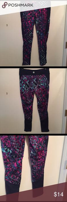 Multicolored workout leggings Durable workout leggings, blues pinks and purples. Deep blue detailing on the sides. Worn once, they pass the squat test (are not see through when you squat). Pants Leggings