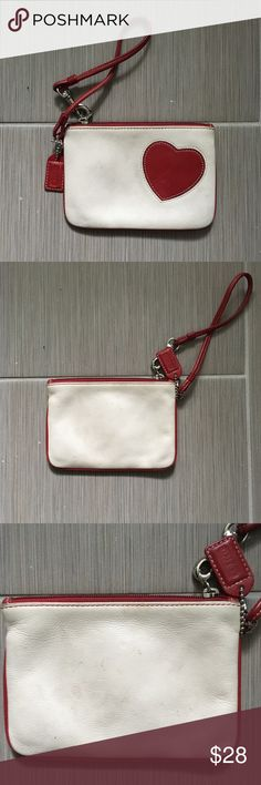 Coach Cream and Red Heart Wristlet In good condition, the inside is very clean, but the cream leather is a bit dirty. It could probably be cleaned up with leather cleaner, but I don't currently have any.   🚫 No Trades or Low-balls!   ✅ Yes to Reasonable Offers and Discounts on Bundles Coach Bags Clutches & Wristlets