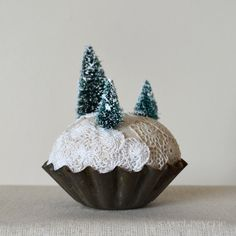 Welcome to the snow covered pine tree forest, a miniature vintage-inspired world of tiny bottle brush evergreens nestled in antique lace and
