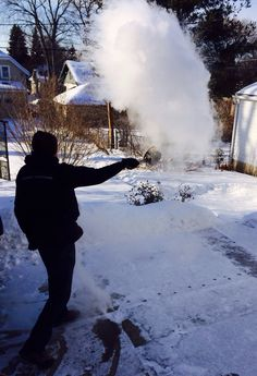 How We Kill Time in Wisconsin: Threw boiling hot water into the super cold minus 12 degrees Fahrenheit air, and watched it immediately vaporize. (Considering the recent visits to the ER for burns, I guess I should add: don't throw the water into the wind, nor onto your nearby children!)