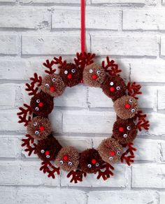 New, handmade Pom Pom Christmas reindeer 10 inch wreath