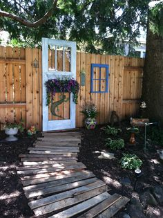 Our summer yard art project.  Repurposed old door and window frame with a pallet path :)