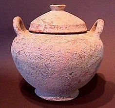 This piece is a Greek lidded vessel that dates to the Late Bronze Age period, circa 12th-11th century B.C.This type of vessel also served as a burial urn, and held the cremated remains of the deceased. This type of vessel was then placed in a cist grave with lined stones, or within an enclosure of piled rocks, and the entire tomb was then covered with a mound of dirt. This type of burial was common throughout the ancient Greek world during the Bronze Age.