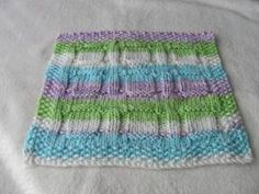 Tested and photo by Ellie :)   Cast on 44st.  Work 6 rows Border      1. B4, K36, B4   2. B4, p36, B4   3.    B4 [k2, p6, k4]3t, B4   4.    ...