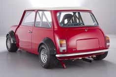 - because race car. Low and wide! Just how they were meant to. Mini Cooper S, Mini Cooper Classic, Cooper Car, Classic Mini, Classic Cars, John Cooper Works, Minis, Mini Morris, Because Race Car