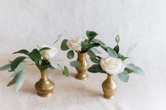 love the texture combo of brass vases and what looks like a gum leaf