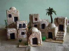 casitas - no tutorial, not for sale at this link - just inspiration: what kind of clay would make these best? use slab technique? coat with dry powdered form of clay or etc. before painting? Christmas Nativity Scene, Christmas Villages, Christmas Holidays, Christmas Crafts, Pottery Houses, Jesus Birthday, Miniature Houses, Garden Crafts, Fairy Houses