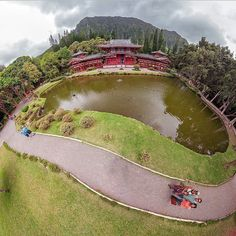 Stereoscopic view of the Byodo Inn Temple with the cloudy Ko'olaus Mountain Range in the background.  Oahu, Hawaii.  I like how the temple is perched on top of the sphere.  The Byodo-In Temple is a non-denominational shrine located on the island of O'ahu in Hawai'i at the Valley of the Temples. It was dedicated in August 1968 to commemorate 100-year anniversary of the first Japanese immigrants to Hawaii.  Photo by PanaViz  #panaviz Hawaii Life, Oahu Hawaii, Mountain Range, Temples, Great Places, Hawaiian, Anniversary, Earth, Japanese