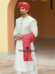 Off White Jamawar Straight Cut Sherwani with bright red headgear Sherwani Groom, Wedding Sherwani, Pakistani Party Wear, Pakistani Wedding Dresses, Marathi Wedding, Punjabi Wedding, Indian Groom Dress, Indian Dresses, Fashion Designer